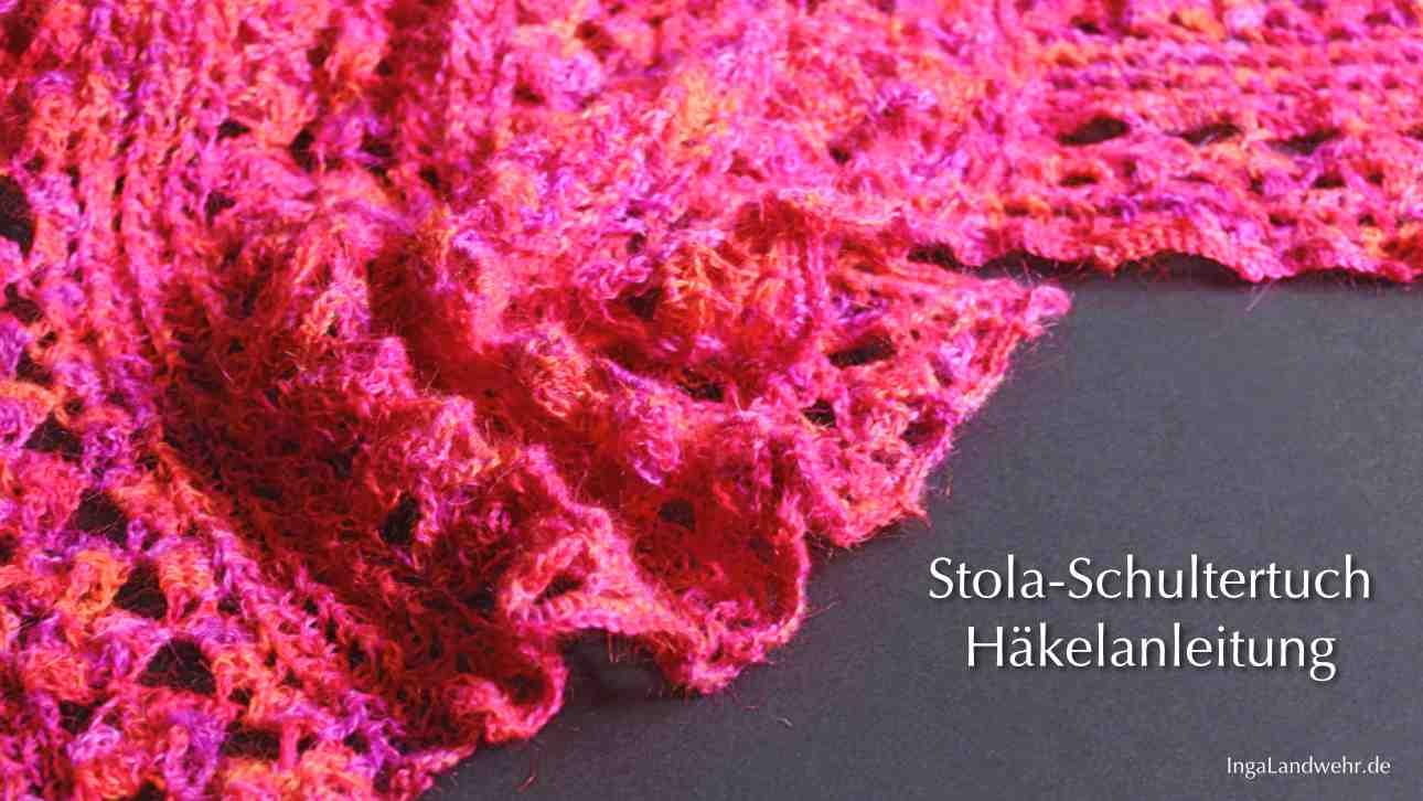 Zusammengeraftes Stola-Schultertuch in pink-rot-violett auf schwarzem Grund